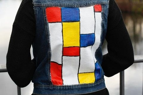 How to make a Mondrian inspired punk vest. .  Free tutorial with pictures on how to make a vest / waistcoat in under 60 minutes using studs, denim jacket, and textile paint. Inspired by inspiration, style, and punk. How To posted by Steffi J.  in the Other section Difficulty: Easy. Cost: Cheap. Steps: 6