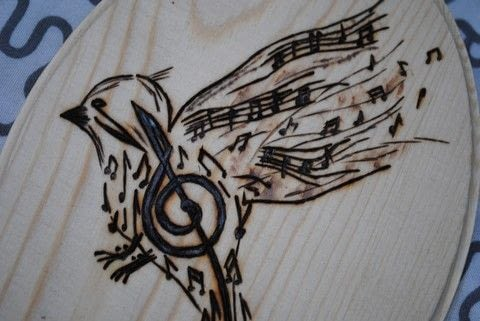 Perfect for someone who loves Music .  Free tutorial with pictures on how to make a piece of wood burned art in under 180 minutes by decorating, transfering, and woodworking with plate, woodburning tool, and printer paper. Inspired by music & bands and birds. How To posted by Lea Bee.  in the Home + DIY section Difficulty: Simple. Cost: Absolutley free. Steps: 3
