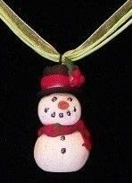 Frosty is always with you .  Free tutorial with pictures on how to sculpt a clay character necklace in under 30 minutes using polymer clay, glitter, and wire. Inspired by christmas and snowmen. How To posted by Laura.  in the Jewelry section Difficulty: Simple. Cost: Cheap. Steps: 3