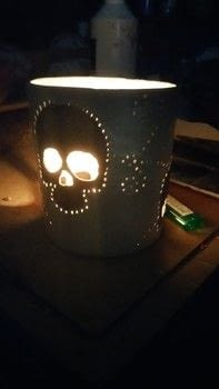 A clay candle holder .  Make a decorative light in under 180 minutes by potting with water, clay, and paintbrushes. Inspired by gifts, christmas, and gothic. Creation posted by bbw_jenn.  in the Art section Difficulty: 3/5. Cost: 3/5.