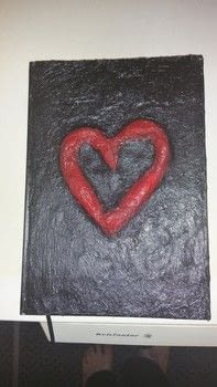 Paper mache coered diary .  Make a paper book cover by decorating, embellishing, molding, and Papier-mâchéing with paint brush, water, and pva glue. Inspired by gothic and hearts. Creation posted by bbw_jenn.  in the Papercraft section Difficulty: Easy. Cost: Absolutley free.