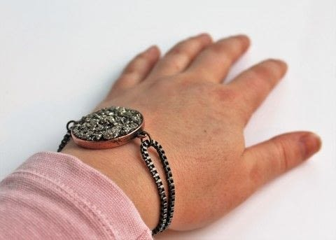 This bracelet is equal parts sparkle and edge. .  Free tutorial with pictures on how to make a bracelet in under 60 minutes by jewelrymaking, mosaic, and  with crystal clay, bezel, and pyrite. How To posted by Caroline.  in the Jewelry section Difficulty: 3/5. Cost: 3/5. Steps: 12