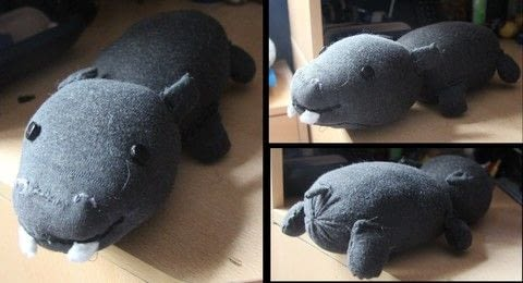 Hippo plushie animal .  Free tutorial with pictures on how to make an animal plushie in 9 steps by sewing and hand sewing with socks, felt, and beads. How To posted by Alma .  in the Needlework section Difficulty: Easy. Cost: Cheap.