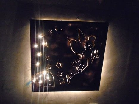 Canvas cut lights .  Free tutorial with pictures on how to make a wall light in under 120 minutes by drawing, spraypainting, transfering, and making electronics How To posted by Hira osman.  in the Home + DIY section Difficulty: Simple. Cost: 3/5. Steps: 6