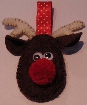 A cheeky reindeer for the tree! .  Make a Christmas tree ornament in under 60 minutes by sewing, yarncrafting, and felting with felt, ribbon, and googley eyes. Inspired by christmas and reindeer. Creation posted by sian d.  in the Needlework section Difficulty: Simple. Cost: Cheap.
