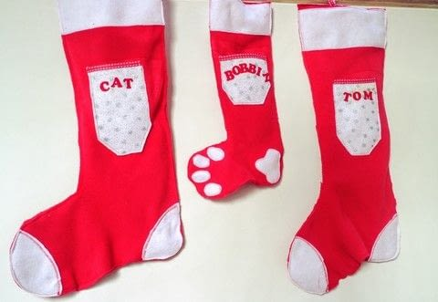 Make your family a set of matching Christmas stockings complete with their name and a pocket for their wishlist! .  Free tutorial with pictures on how to make a Christmas stocking in under 60 minutes by sewing with fleece, felt, and template. Inspired by christmas. How To posted by Cat Morley.  in the Sewing section Difficulty: Simple. Cost: Cheap. Steps: 11