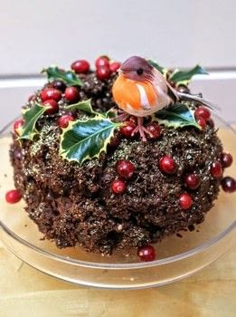 A chocolate cake crossed with Christmas pudding covered in a chocolate nutty nest topping! .  Free tutorial with pictures on how to bake a chocolate cake in under 120 minutes by cooking and baking with orange, brown sugar, and water. Inspired by christmas. Recipe posted by Cat Morley.  in the Recipes section Difficulty: Simple. Cost: Cheap. Steps: 20
