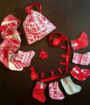 Stocking Advent Calendar .  Make bunting in under 180 minutes by hand sewing and machine sewing with cotton cloth, ribbon, and wood. Inspired by christmas. Creation posted by LoupLou.  in the Sewing section Difficulty: 3/5. Cost: 3/5.