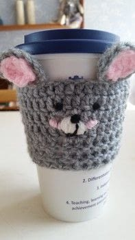 Keep your drinks toasty or your fingers cosy .  Make a cup / mug in under 60 minutes by crocheting and hand sewing with wool. Inspired by rabbits. Creation posted by LoupLou.  in the Yarncraft section Difficulty: Simple. Cost: Cheap.