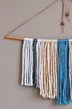 Jazz up your wall with a yarn hanging! .  Free tutorial with pictures on how to make a yarn wall hanging in under 45 minutes using scissors, yarn, and string. How To posted by Fariha H.  in the Home + DIY section Difficulty: Easy. Cost: Cheap. Steps: 5