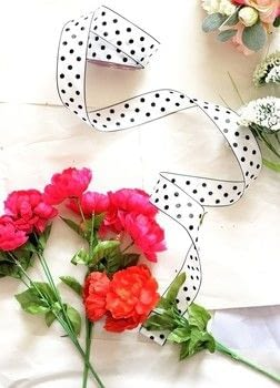 Get ready for spring with this easy wreath tutorial! .  Free tutorial with pictures on how to make a floral wreath in under 40 minutes by decorating with ribbon, pliers, and flowers. Inspired by polka dot. How To posted by Fariha H.  in the Home + DIY section Difficulty: Easy. Cost: Cheap. Steps: 3