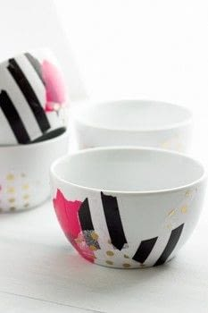 We're taking plain old boring white bowls and jazzing them up with. *drumroll please*.. tissue paper! .  Free tutorial with pictures on how to make a bowl or basket in under 20 minutes by decoupaging with bowl, decoupage glue, and foam brush. How To posted by Fariha H.  in the Home + DIY section Difficulty: Simple. Cost: Cheap. Steps: 5