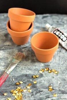 Learn how to turn mini planters into a glamorous accent piece for your home with just three items! .  Free tutorial with pictures on how to make a vase, pot or planter in under 25 minutes using glue, studs, and planter. How To posted by Fariha H.  in the Home + DIY section Difficulty: Easy. Cost: Absolutley free. Steps: 3