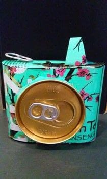 Camera using aluminum can .  Make a decoration in under 60 minutes using aluminum cans, scissors, and hot glue gun and glue sticks. Inspired by camera. Creation posted by kneellock.  in the Art section Difficulty: Simple. Cost: Cheap.