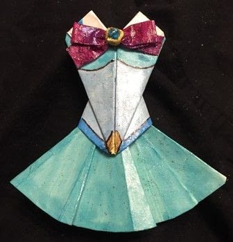 Sailor Moon fuku:Sailor Doodle Style! .  Fold a piece of origami clothing in under 90 minutes by creating, drawing, decorating, embellishing, papercrafting, and paper folding with paper, acrylic paint, and mod podge. Inspired by comic books, anime & manga, and sailor moon. Creation posted by Kinhime Dragon.  in the Papercraft section Difficulty: Easy. Cost: No cost.