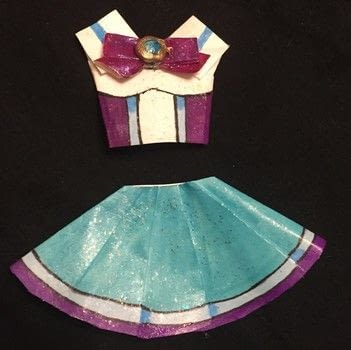 .  Fold a piece of origami clothing in under 90 minutes Inspired by comic books, anime & manga, and sailor moon. Version posted by Kinhime Dragon. Difficulty: Easy. Cost: No cost.
