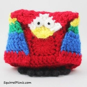 Amigurumi + Origami = a fun pattern to create one adorable bird! .  Free tutorial with pictures on how to make a parrot plushie in under 60 minutes by crocheting with worsted weight yarn, crochet hook, and yarn. Inspired by birds and parrots. How To posted by Jennifer Olivarez.  in the Yarncraft section Difficulty: Simple. Cost: Cheap. Steps: 11