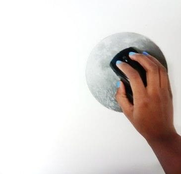 DIY Moon Mouse Pad .  Free tutorial with pictures on how to make a mousepad in under 60 minutes using trivet, masking tape, and spray paint. Inspired by moon. How To posted by Timia L.  in the Home + DIY section Difficulty: Easy. Cost: Absolutley free. Steps: 3