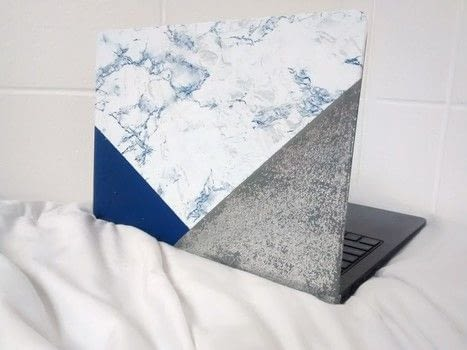 DIY Glitter and Marble Laptop Skin .  Free tutorial with pictures on how to make a decorated gadgets in under 30 minutes by decorating with contact paper, acrylic paint, and glitter. Inspired by marble. How To posted by Timia L.  in the Home + DIY section Difficulty: Easy. Cost: Absolutley free. Steps: 4