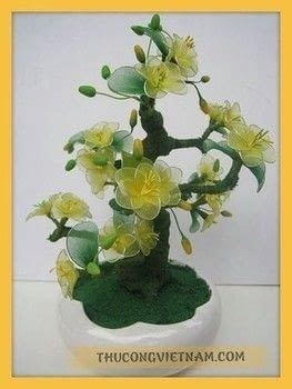 How to make apricot blossoms for Tet holiday .  Free tutorial with pictures on how to make a plant marker in under 120 minutes using fabric. Inspired by beauty and the beast and flowers. How To posted by Vinacraft.  in the Other section Difficulty: Easy. Cost: 3/5. Steps: 2