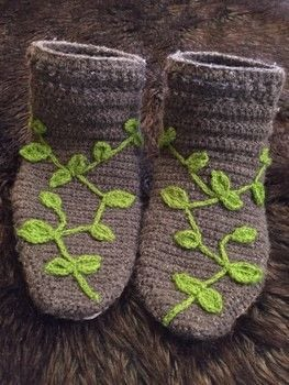 Cozy warm elfin crochet socks with leafy vines .  Stitch a pair of knit or crochet slippers by embellishing, yarncrafting, crocheting, and hand sewing with scissors, crochet hook, and needle and thread. Inspired by elves. Creation posted by malletralle.  in the Yarncraft section Difficulty: Simple. Cost: Cheap.