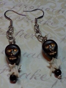 Skull and Bone Earrings .  Make a dangle earring in under 30 minutes by jewelrymaking with beads, earring hooks, and faux pearls. Inspired by skulls & skeletons and snakes. Creation posted by Debora S.  in the Jewelry section Difficulty: 3/5. Cost: 3/5.