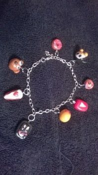 Clay charm bracelet & earings  .  Free tutorial with pictures on how to sculpt a clay character bracelet in under 90 minutes by jewelrymaking with clay, varnish, and silver chain. How To posted by Super Madcow.  in the Jewelry section Difficulty: Easy. Cost: Cheap. Steps: 7