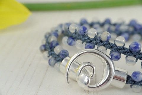 Try the new Prumihimo disk to create this wrap bracelet with Sodalite and White Agate rounds .  Free tutorial with pictures on how to braid a braided bead bracelet in under 90 minutes using rounds, agate, and thread. Inspired by blue. How To posted by Helen Bowen.  in the Jewelry section Difficulty: Simple. Cost: 3/5. Steps: 10