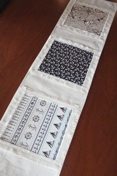 Easily change the look of your table to fit the season .  Free tutorial with pictures on how to make a tablecloth / table runner in under 90 minutes by machine sewing with table runner, fringe, and scrapbook paper. How To posted by CraftyStaci.  in the Needlework section Difficulty: Simple. Cost: 3/5. Steps: 11