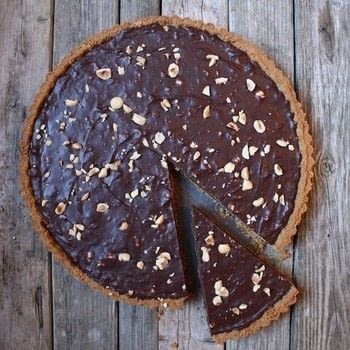 Chocolate hazelnut tart with graham cracker crust. .  Free tutorial with pictures on how to bake a chocolate tart in under 40 minutes by cooking with graham cracker crumbs, butter, and salt. Recipe posted by Holly S.  in the Recipes section Difficulty: 3/5. Cost: Cheap. Steps: 7