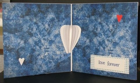 Time to create a project using the fluttering heart pop up tutorial .  Free tutorial with pictures on how to make a pop up card in under 20 minutes by papercrafting, cardmaking, and paper folding with cardstock, cardstock, and patterned paper. Inspired by valentine's day and hearts. How To posted by Peg R.  in the Papercraft section Difficulty: Easy. Cost: 3/5. Steps: 7