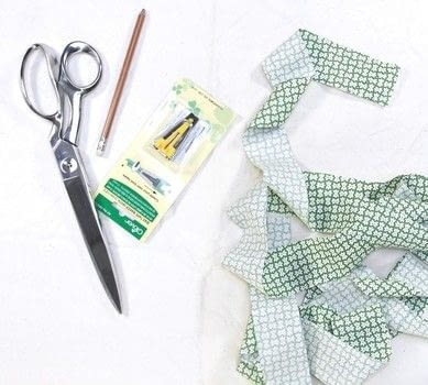 Make your own bias tape. .  Free tutorial with pictures on how to make a supplies in under 30 minutes by sewing and machine sewing with fabric, thread, and scissors. How To posted by Heather M. Love.  in the Sewing section Difficulty: Simple. Cost: Cheap. Steps: 16