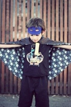 DIY superhero cape. .  Free tutorial with pictures on how to make a cape / cloak in under 120 minutes by sewing with fabric, scissors, and thread. Inspired by kids and super hero. How To posted by Annie M.  in the Sewing section Difficulty: Easy. Cost: No cost. Steps: 7