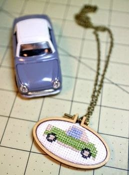 A mini embroidery hoop necklace with a tiny cross-stitched Nissan Figaro! .  Free tutorial with pictures on how to make a stitched necklace in under 35 minutes by jewelrymaking and cross stitching with embroidery needle, embroidery floss, and aida cloth. Inspired by nissan figaro. How To posted by Cat Morley.  in the Needlework section Difficulty: Simple. Cost: Cheap. Steps: 7