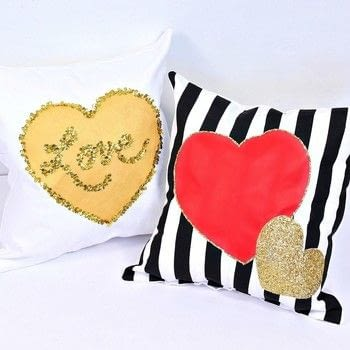 Add some LOVE to your decor with these cute Valentine's Day Pillows! .  Free tutorial with pictures on how to sew an applique cushion in under 120 minutes by sewing, hand sewing, and machine sewing with glitter, fabric, and pillow. How To posted by Mark Montano.  in the Sewing section Difficulty: Simple. Cost: Cheap. Steps: 7