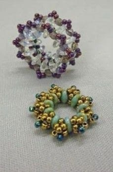 Learn how-to bead a gear and sun with Karen Kubby from Beadology .  Free tutorial with pictures on how to make a beaded pendant in under 60 minutes by beading and jewelrymaking with rounds, beads, and rounds. How To posted by Shop Showcase.  in the Jewelry section Difficulty: Simple. Cost: Cheap. Steps: 18