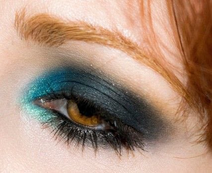 Blue and black smokey look .  Free tutorial with pictures on how to create a smokey eye in under 10 minutes by applying makeup with eye pencil, eyeshadow, and eyeshadow. Inspired by blue. How To posted by Patricia V.  in the Beauty section Difficulty: Simple. Cost: No cost. Steps: 11