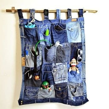 Stylish handy pocket organiser made with old jeans. .  Free tutorial with pictures on how to make a wall tidy storage unit in under 120 minutes using jeans, branch, and scissors. Inspired by homeware. How To posted by pillarboxblue.  in the Home + DIY section Difficulty: 3/5. Cost: Absolutley free. Steps: 5