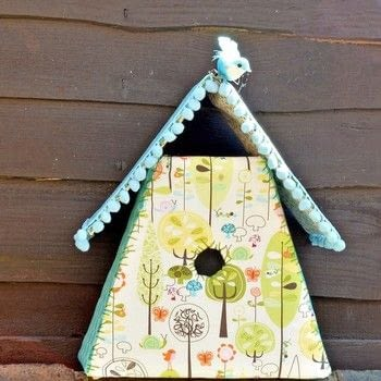 Gorgeous fabric birdhouses .  Free tutorial with pictures on how to make a bird house in under 120 minutes by sewing with template, fabric scraps, and needle and thread. Inspired by crafts, birds, and birdcages. How To posted by pillarboxblue.  in the Needlework section Difficulty: Simple. Cost: Cheap. Steps: 5
