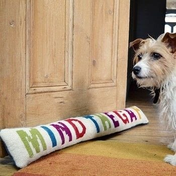 """""""Mind The Gap"""" draught excluder .  Free tutorial with pictures on how to make a draft stopper in 6 steps by sewing with tapestry needle, scissors, and jeans. Inspired by dogs and homeware. How To posted by pillarboxblue.  in the Needlework section Difficulty: Simple. Cost: Cheap."""
