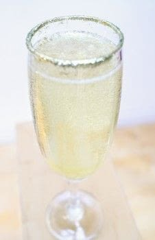 A sparkling champagne cocktail with Unicorn Tears gin liqueur, gold edible glitter and popping candy! .  Free tutorial with pictures on how to mix a champagne cocktail in under 5 minutes by mixing drinks with prosecco, gin, and popping candy. Recipe posted by Cat Morley.  in the Recipes section Difficulty: Simple. Cost: Cheap. Steps: 6