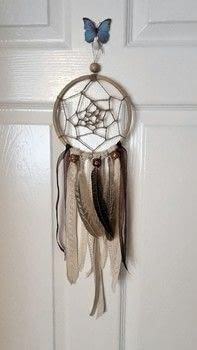 Hand made bohemian style dreamcatcher. .  Make a home / garden project in under 150 minutes by weaving with beads, ribbon, and ribbon. Inspired by dreamcatchers, feathers, and bohemian. Creation posted by JoanneElisabeth.  in the Other section Difficulty: Easy. Cost: 3/5.