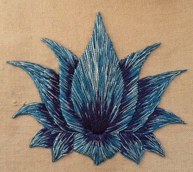 What Can I Sew in 20 Minutes a Day? Lotus Flower Video .  Free tutorial with pictures on how to embroider art in 1 step by creating, needleworking, embroidering, sewing, and hand sewing with fabric and stranded cotton. How To posted by CraftJitsu.  in the Needlework section Difficulty: Easy. Cost: Absolutley free.