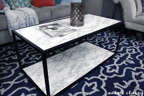 DIY Faux Marble Coffee Table .  Free tutorial with pictures on how to make a coffee table in under 30 minutes using scissors, sponge, and xacto knife. How To posted by ArtsandClassy.  in the Home + DIY section Difficulty: Simple. Cost: Absolutley free. Steps: 3