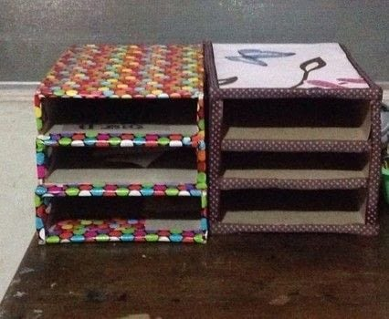 Recycled paper organizer .  Make a craft organizers in under 30 minutes using cereal box, foam board , and hot glue gun and glue sticks. Inspired by organization and green. Creation posted by LoveCrafting.  in the Other section Difficulty: Easy. Cost: Absolutley free.
