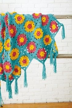 10 Granny Squares 30 Blankets .  Free tutorial with pictures on how to crochet a granny square blanket in 5 steps by crocheting with yarn and crochet hook. How To posted by Creative Publishing international.  in the Yarncraft section Difficulty: 3/5. Cost: 3/5.