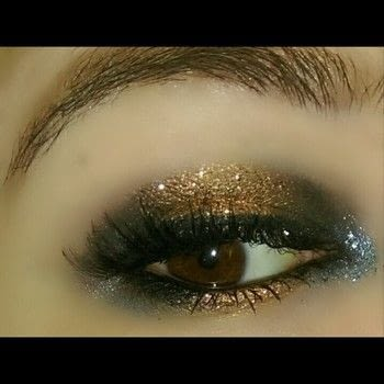2 toned glitter eye makeup .  Free tutorial with pictures on how to create a two toned eye makeup look in under 15 minutes by applying makeup with liquid eyeliner, eyeshadow primer, and eyeliner pencil. How To posted by Brittny H.  in the Beauty section Difficulty: 3/5. Cost: 3/5. Steps: 8