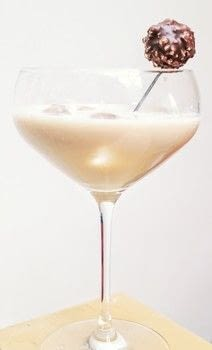 A Ferrero Rocher inspired dessert martini .  Free tutorial with pictures on how to mix a martini in under 5 minutes by mixing drinks with gin, irish cream, and liqueur. Recipe posted by Cat Morley.  in the Recipes section Difficulty: Simple. Cost: Cheap. Steps: 4