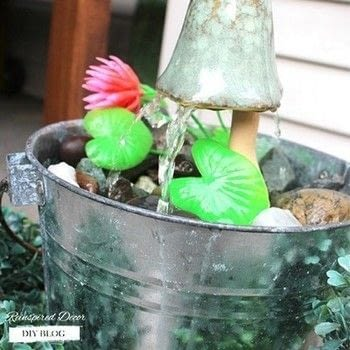An easy way to add a unique water feature to your patio or backyard. .  Free tutorial with pictures on how to make a garden decoration in under 60 minutes using tubing, bucket, and decorations. Inspired by garden. How To posted by reinspireddecor.  in the Home + DIY section Difficulty: Easy. Cost: Cheap. Steps: 5