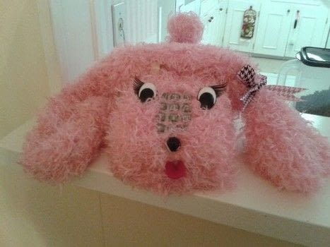 It's a poodle phone! .  Free tutorial with pictures on how to decorate a phone in under 120 minutes by decoupaging and hand sewing Inspired by crafts and poodle. How To posted by Joanne C.  in the Other section Difficulty: 3/5. Cost: Absolutley free. Steps: 2